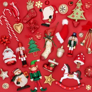 Christmas decorations and tree ornaments on red background. Traditional theme with symbols for the festive season.