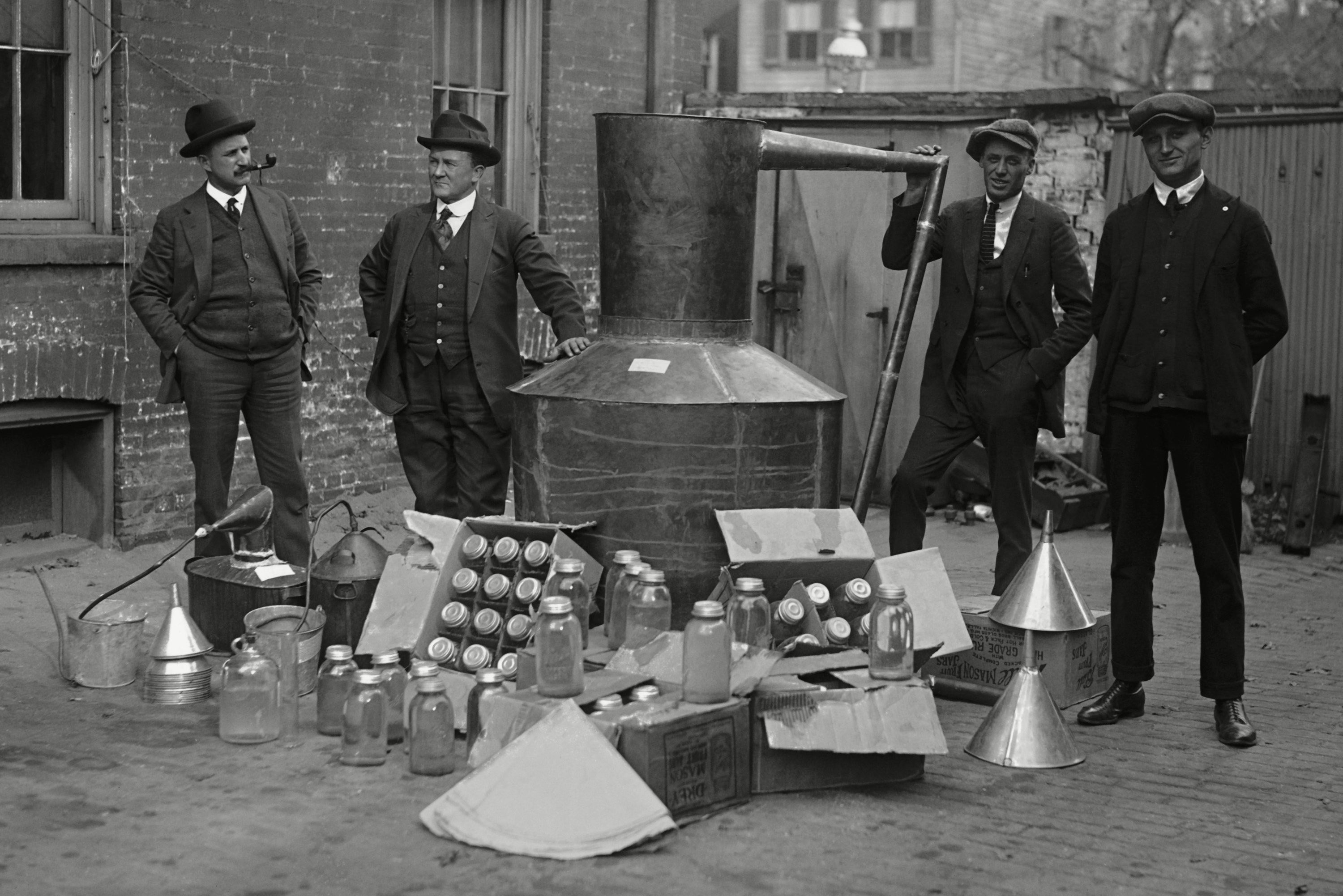 Mandatory Credit: Photo by Everett/Shutterstock (10112290a) Prohibition agents stand with a still and mason jars used to distill hard liquor in Wash. D.C. area. Nov. 11, 1922