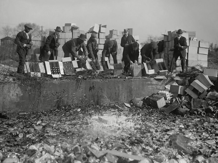 Mandatory Credit: Photo by Everett/Shutterstock (10112301a)<br /> Government agents destroying whiskey and beer during Prohibition. Washington, DC area, Nov. 20, 1923