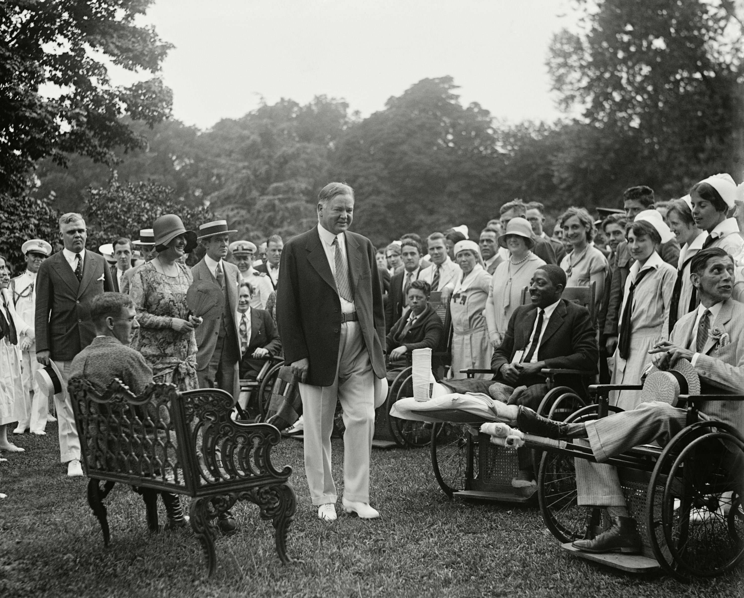 Mandatory Credit: Photo by Everett/Shutterstock (10112329a) President Herbert Hoover and the First Lady at a White House reception for Veterans, June 27, 1929. The inclusion of an African American in a photographed event was likely requested by Hoover