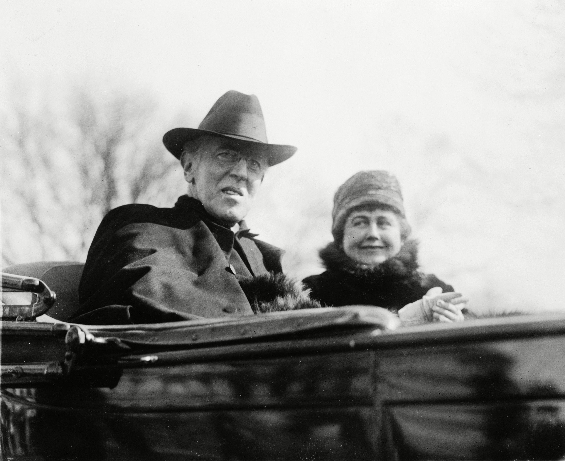 Mandatory Credit: Photo by Everett/Shutterstock (10274815a) Ex-President Woodrow Wilson (1856-1924) and his second wife, Edith Bolling Galt Wilson riding in an open carriage in Washington, DC in 1923. President Wilson shows the effects of a severe stroke he suffered in October 1919. Historical Collection