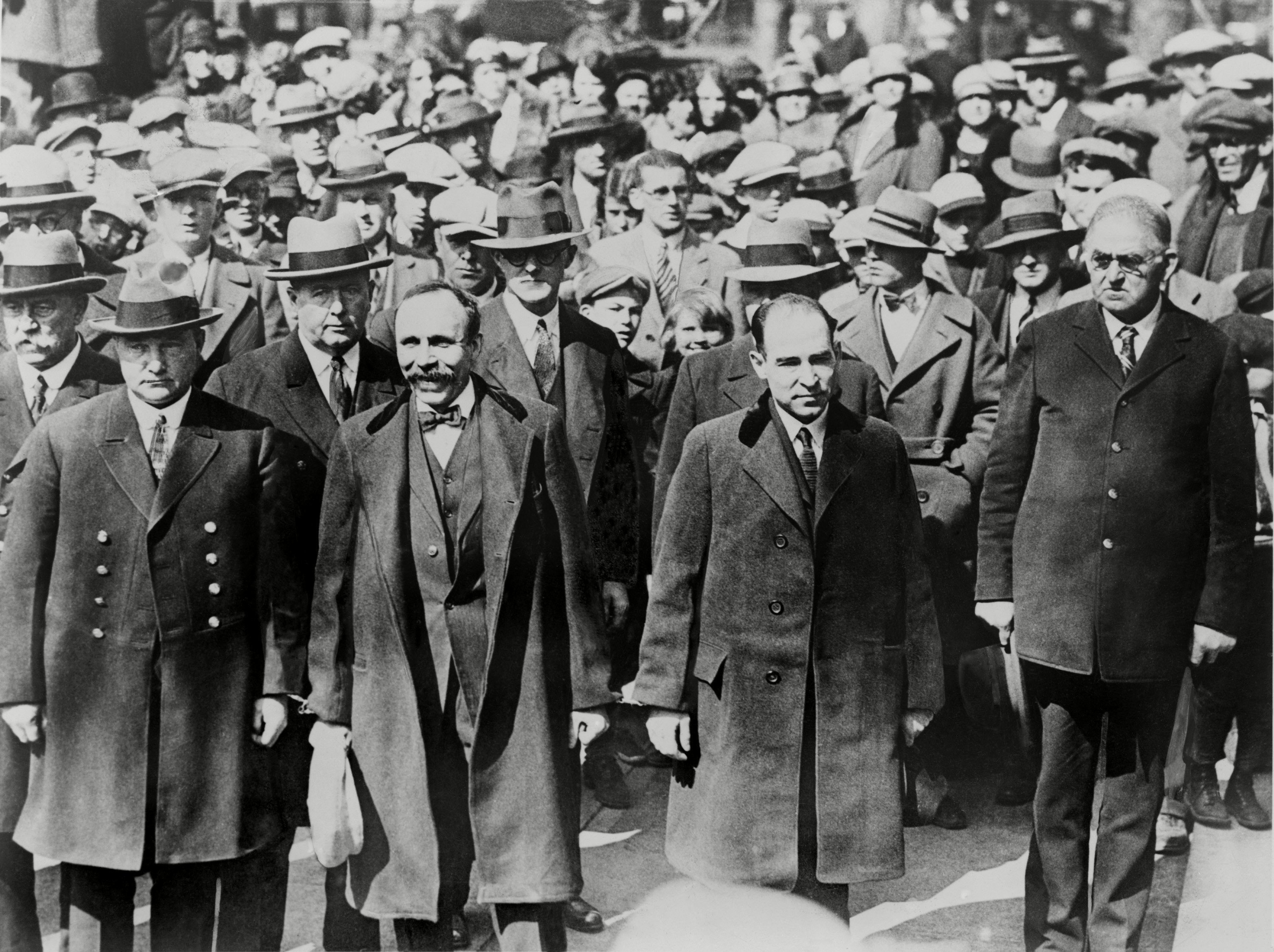 Mandatory Credit: Photo by Everett/Shutterstock (10277914a) Bartolomeo Vanzetti (left) and Nicola Sacco, manacled together before they received death sentences for payroll guard murder they were convicted of seven years earlier. They are surrounded by heavy guard and onlookers, as they enter the courthouse at Dedham, Massachusetts. Historical Collection