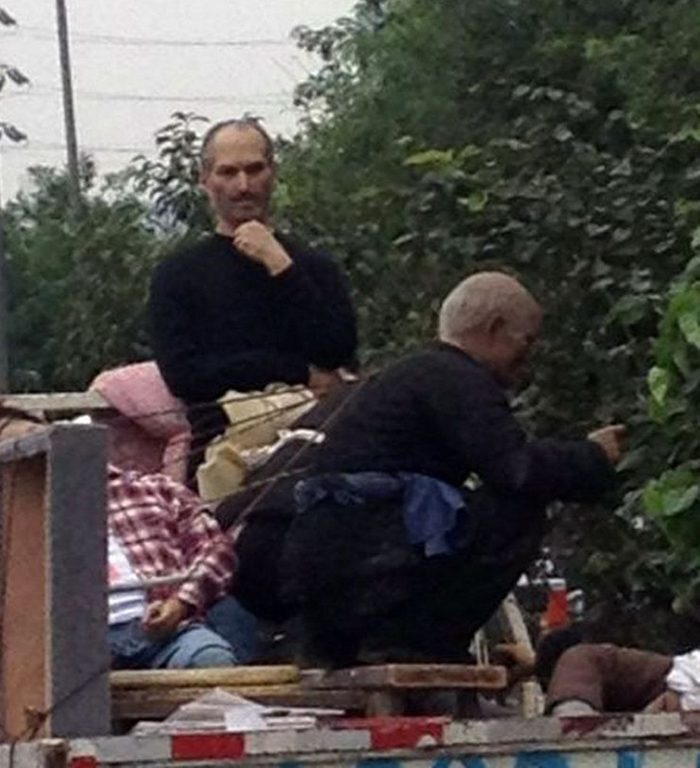 """Mandatory Credit: Photo by Hap/Quirky China News/Shutterstock (1896976b) The Steve Jobs lookalike Rubbish collector looks like late Apple founder Steve Jobs, Xi'an, Shaanxi Province, China - 26 Sep 2012 A Chinese rubbish collector who looks surprisingly like the late Steve Jobs has been spotted Xi'an, capital of western China's Shaanxi Province. The man, who bears an uncanny likeness to the Apple founder, was spotted sitting on heap of rubbish in the back of a lorry. """"I was terrified in seeing him. That's Steve Jobs,"""" said Wang Wei, who took the picture with his cell phone."""