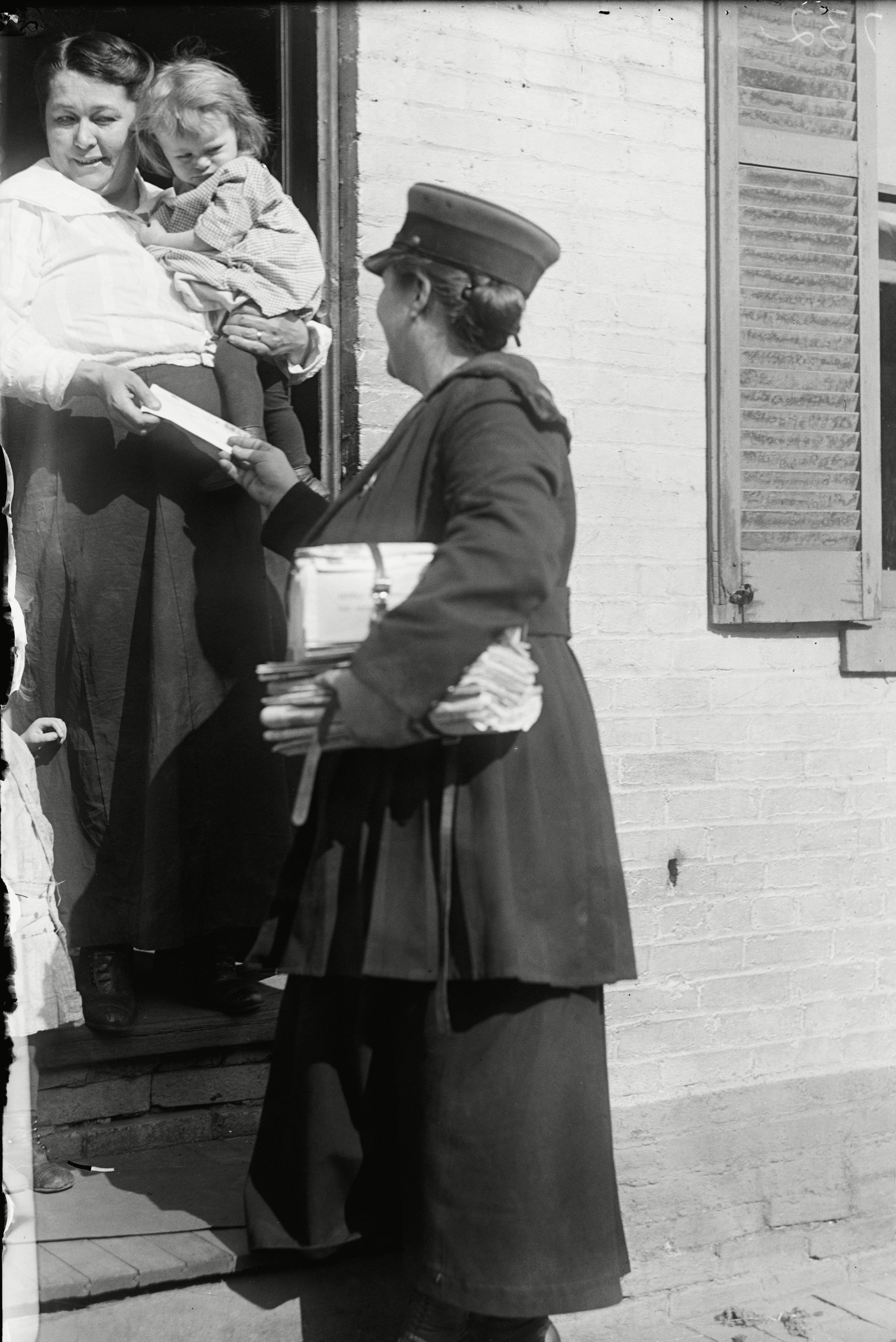 Mandatory Credit: Photo by Nara Archives/Shutterstock (2153677a) Washington, Dc, 1917 - Mrs. Parmlee Campbell, Woman Mail Carrier, Delivering Mail To Mrs. Nellie Mcgrath Various