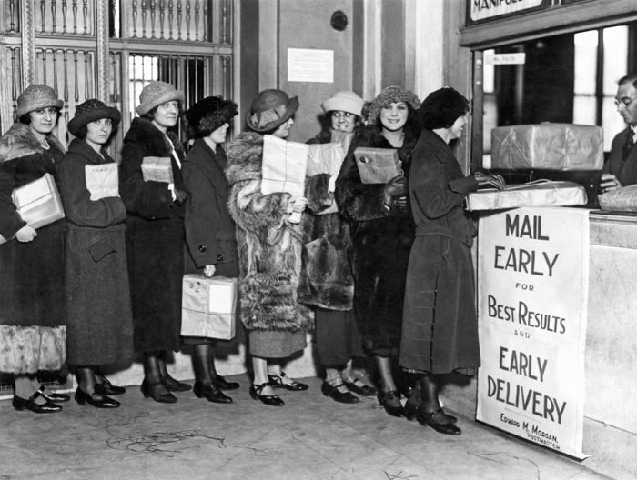 Mandatory Credit: Photo by Underwood Archives/UIG/Shutterstock (3837410a) New York, New York: c. 1923. These women have already bought all their presents and are mailing them early, just like the sign says. VARIOUS