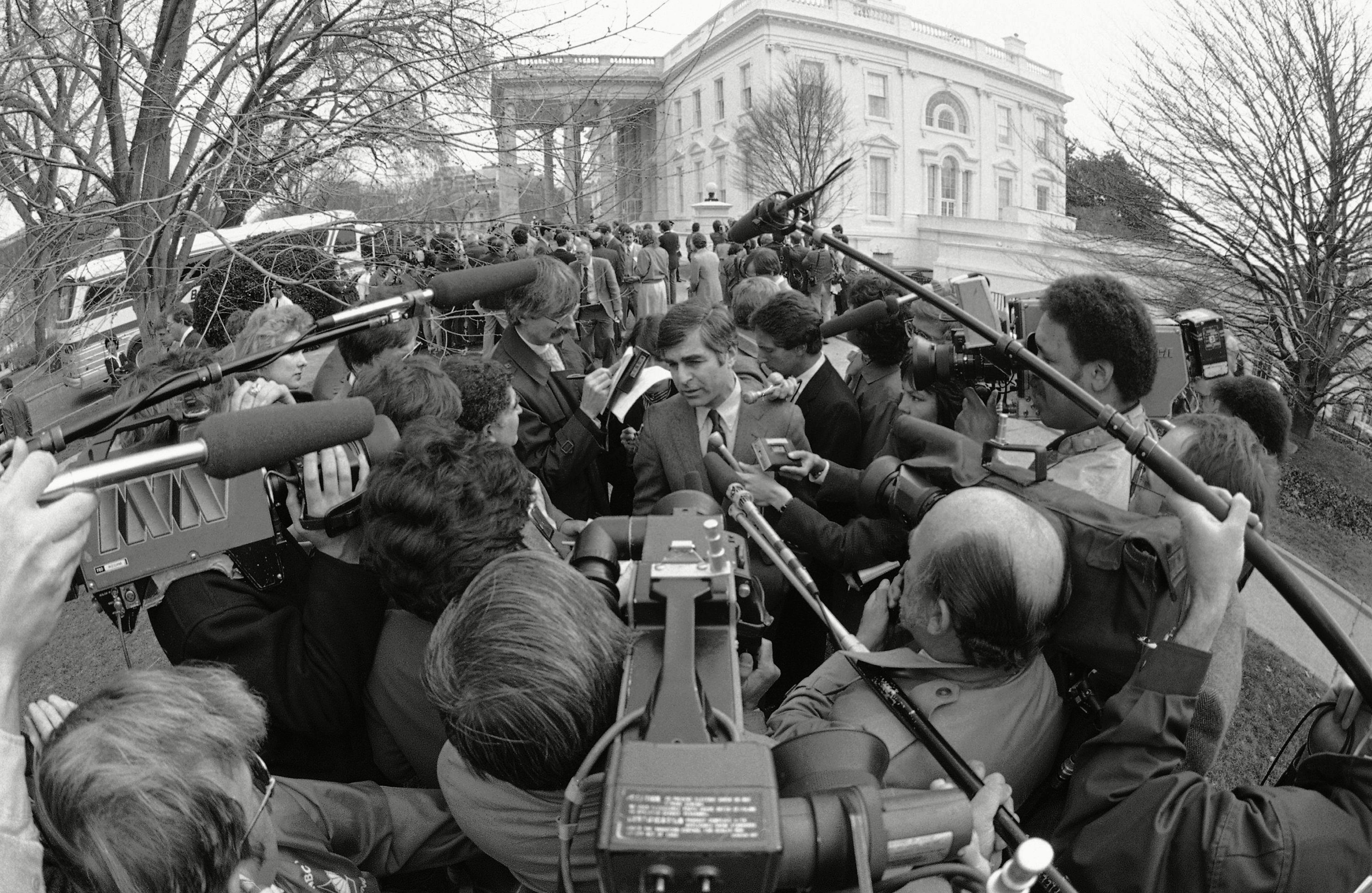 Mandatory Credit: Photo by Scott Applewhite/AP/Shutterstock (6004396a) Michael Dukakis Gov. Michael Dukakis of Mass., who had just left the White House after hearing President Reagan speaks to members of the National Governor?s Association, is surrounded by members of the news media, in Washington, who were seeking details of the speech by the President Gov. Michael Dukakis and News Media, Washington, USA