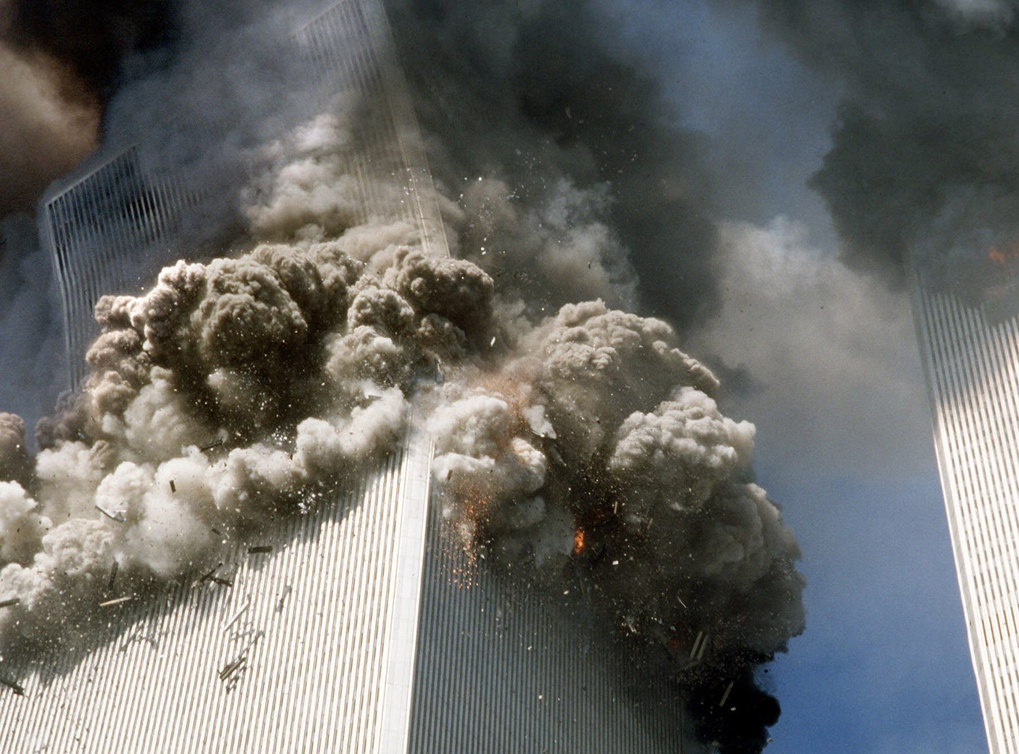 """Mandatory Credit: Photo by Gulnara Samoilova/AP/Shutterstock (6476039a) WORLD TRADE CENTER Federal investigators believe the second World Trade Center tower fell much more quickly than the first because it faced a more concentrated, intense fire inside, officials said . Investigators have singled out this Associated Press photograph that they said may provide evidence to support their theory which shows a """"kink"""" in the building's corner at the 106th floor TRADE CENTER COLLAPSE, NEW YORK, USA"""