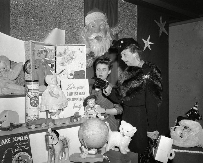 Mrs. Eleanor Roosevelt makes a Christmas purchase in a New York department store