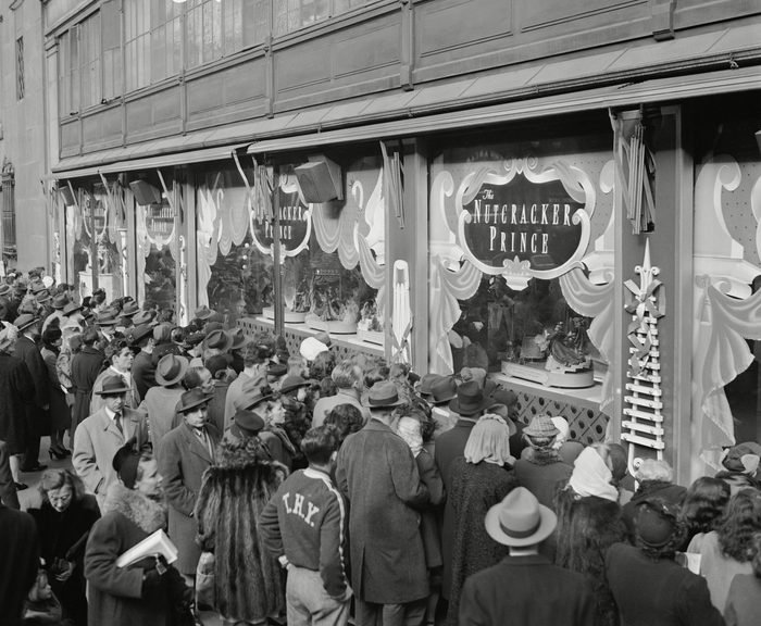 Last minute Christmas Eve shoppers gather in front of Macy's window display in New York.