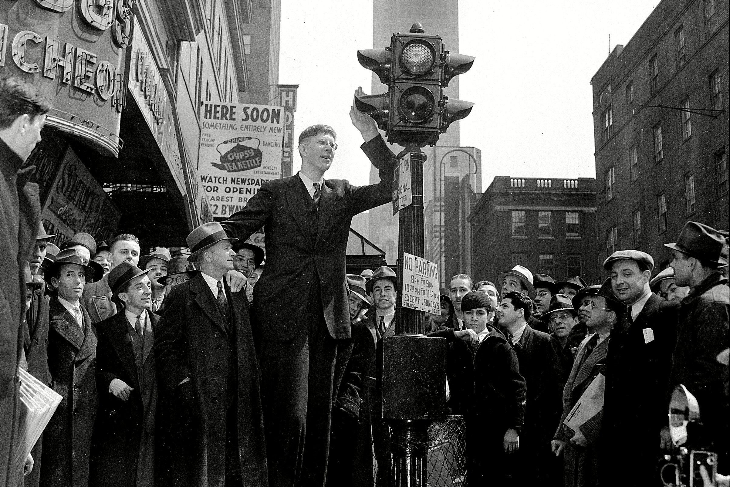 Mandatory Credit: Photo by AP/Shutterstock (6666473a) Wadlow Robert Wadlow, 18, of Alton, Ill., waits at a pedestrian traffic light as he is surrounded by a crowd in New York City, . Robert is standing with his father and manager, Harold Wadlow, left, with whom he is on a nationwide tour of schools, theaters and lecture halls. Robert, who is 8 feet and 4 inches tall, will join the Ringling Brothers Circus for a six-week appearance NYC ROBERT WADLOW, NEW YORK, USA