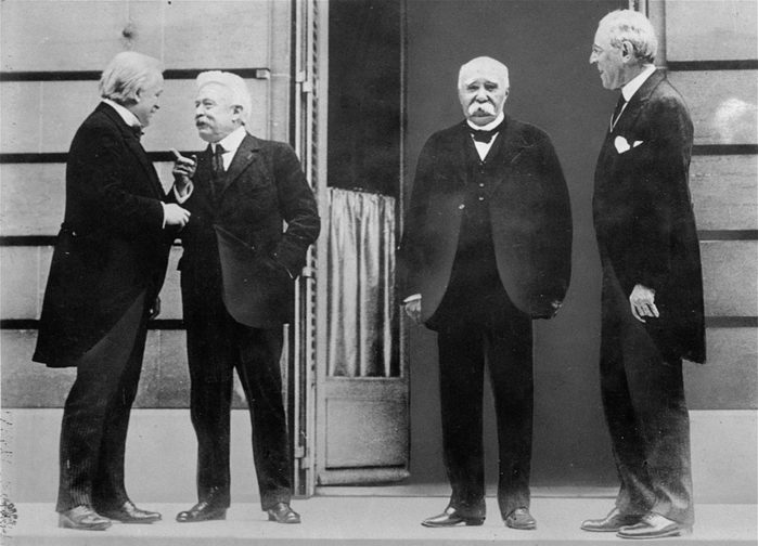 Mandatory Credit: Photo by AP/Shutterstock (7393336a) The Big Four of the Allies chat while gathering in Versailles for the Treaty of Versailles, which officially ended World War I, in this 1919 photo. They are, left to right, David Lloyd George, of Great Britain, Vittorio Orlando, of Italy, Georges Clemenceau, of France, and Woodrow Wilson, United States President BIG FOUR PEACE TREATY, VERSAILLES, France