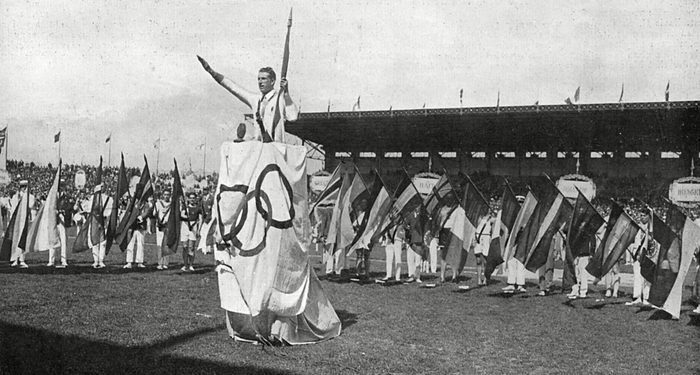 Mandatory Credit: Photo by Historia/Shutterstock (7665077dj) Surrounded by the Flags of All Forty-five Nations Taking Part in the 1924 Paris Olympic Games George Andre the Famous French Athlete Takes the Oath of Loyalty On Behalf of All Competitors 1924 Historical Collection 177