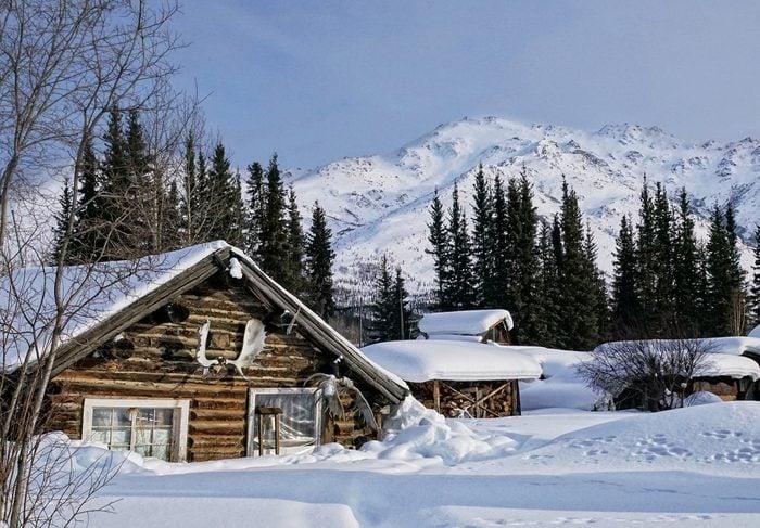 charming cabin alaska winter snow