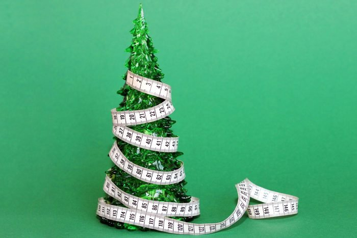 miniature fake christmas tree wraped in measuring tape