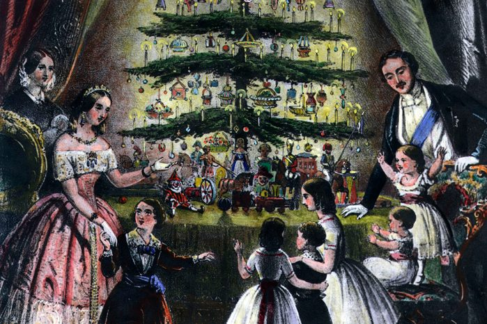 Illustration of December 1848: The Royal Christmas tree is admired by Queen Victoria, Prince Albert and their children.