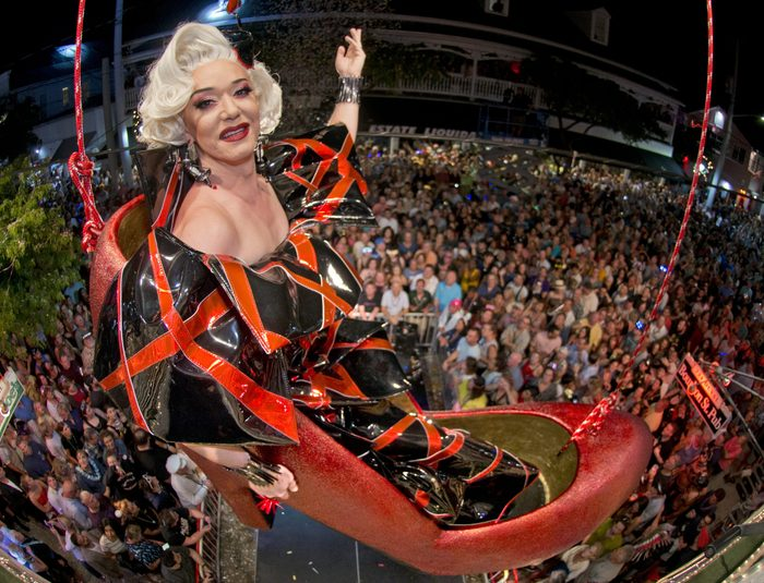 Gary Marion, attired as drag queen Sushi, hangs in an oversized replica of a women's red high heel over Duval Street, late Monday, Dec. 31, 2018, at the Bourbon St. Pub in Key West, Fla. The Red Shoe Drop is a Key West tradition and is one of six Key West warm-weather takeoffs on New York City's Times Square ball drop to mark the beginning of a new year. FOR EDITORIAL USE ONLY (Andy Newman/Florida Keys News Bureau/HO)
