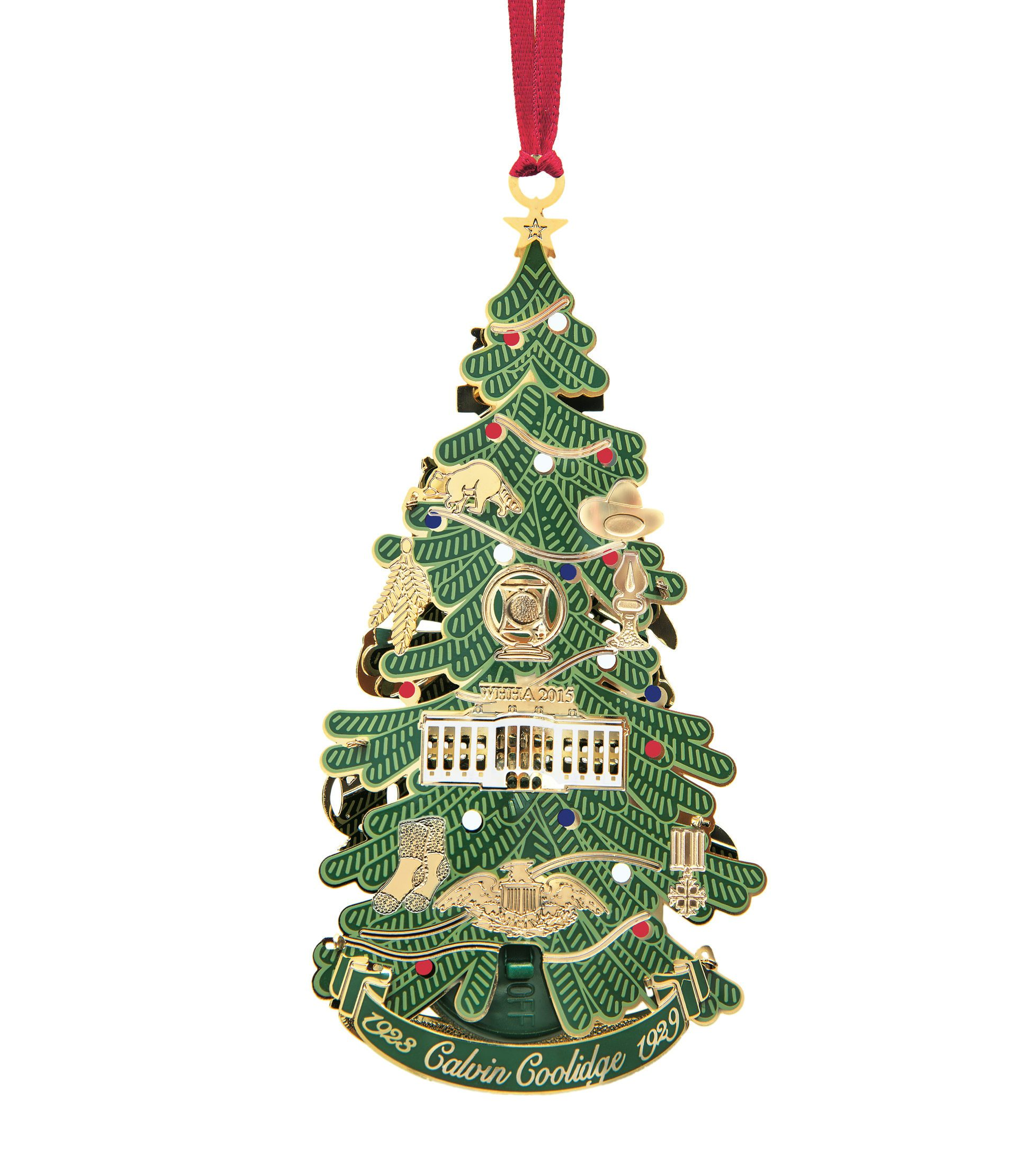 This image is the Back view (with string) of the 2015 White House Christmas Ornament that honors the administration of Calvin Coolidge, who served as the 30th President of the United States from 1923 to 1929. A depiction of the first National Christmas tree, it features ornaments representing the events of Coolidge's life and presidency. On Christmas Eve in 1923 President Coolidge lit strings of more than 2,500 electric bulbs on the first National Christmas Tree, an annual tradition that continues to this day. In honor of this, the ornament illuminates from a light inside the tree.