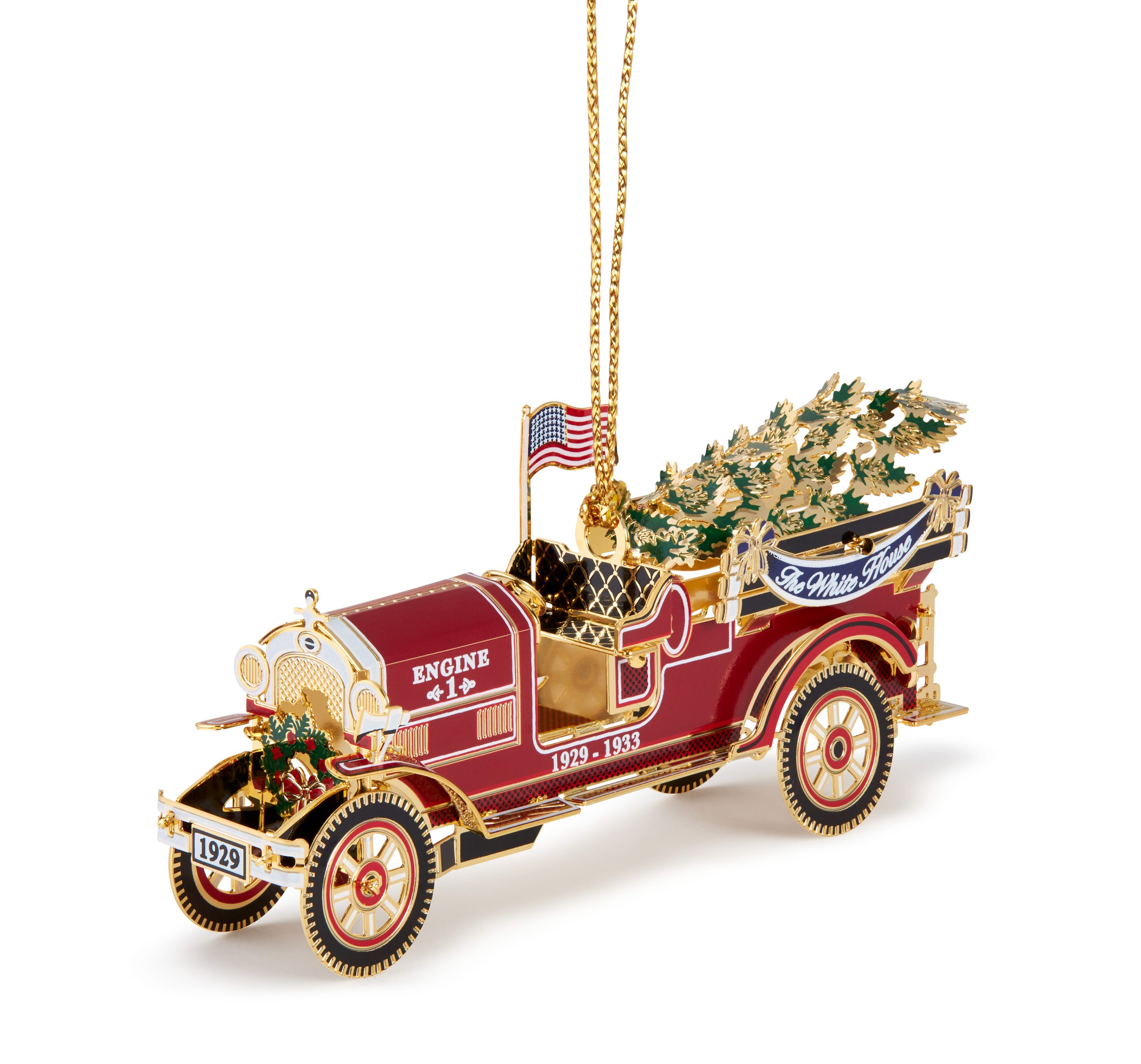 This image is the 3-Quarter Left view (with string) of the 2016 White House Christmas Ornament that honors President Herbert Hoover, the 31st President of the United States who was in office from 1929 to 1933. Inspired by the fire engines that responded to a 1929 Christmas Eve fire at the White House, the ornament also honors the toy trucks that were presented to children by the Hoovers' the following Christmas.