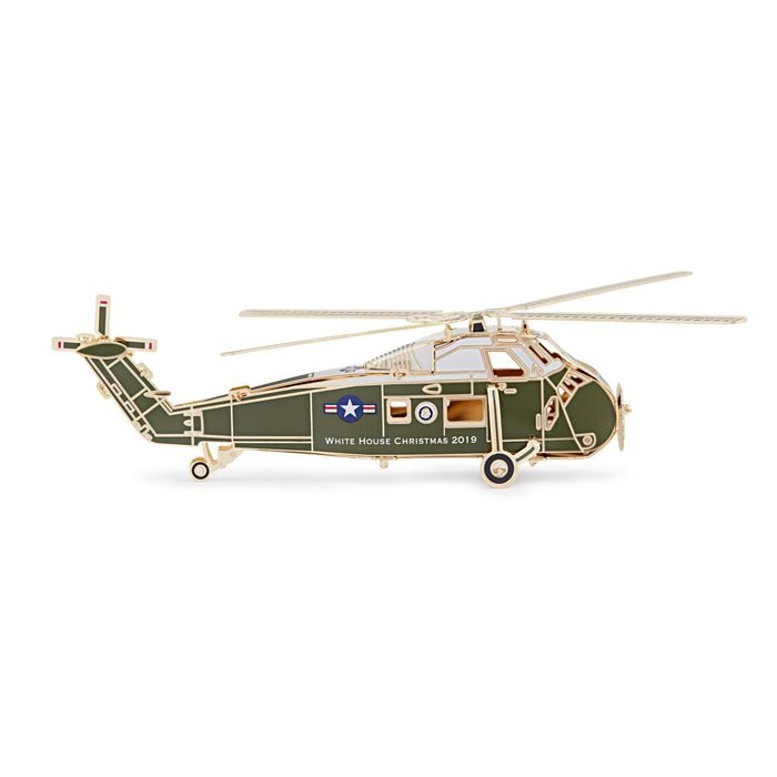The White House Historical Association's 2019 Official White House Christmas Ornament honors Dwight D. Eisenhower, 34th president of the United States. The design of the 2019 ornament follows President Eisenhower's example of fairness: as the first president to regularly use a helicopter, he had two Executive Flight Detachments for his transport provided by flight crews of the United States Army and the United States Marine Corps. To demonstrate his impartiality, Eisenhower alternated between these helicopters and their respective military personnel. Likewise the 2019 ornament does not represent a single branch of the military. One side features the Presidential Seal, representing Eisenhower's two terms as commander in chief of the Armed Forces. On the other is his five-star rank, honoring his military service as a general in the United States Army. The 39th Official White House Christmas Ornament is American-made by a veteran-owned company and continues the tradition of honoring U.S. presidents in sequential order. The sale of every ornament supports the Association's mission to preserve, protect, and provide public access to the White House and educate the public on its history.