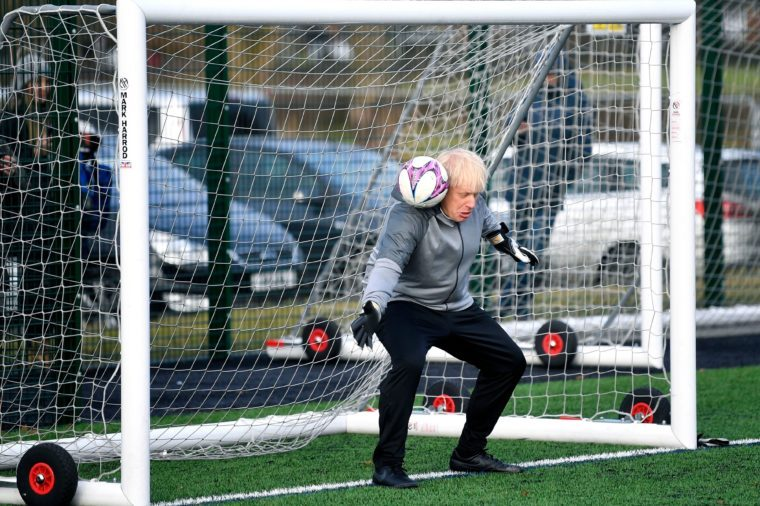 Britain's Prime Minister Boris Johnson stands in goal prior to a Juniors girls' soccer match between Hazel Grove United JFC and Poynton, as he campaigns in Cheadle Hulme, England, . Britain goes to the polls on Dec. 12 Brexit Election, Cheadle Hulme, United Kingdom - 07 Dec 2019
