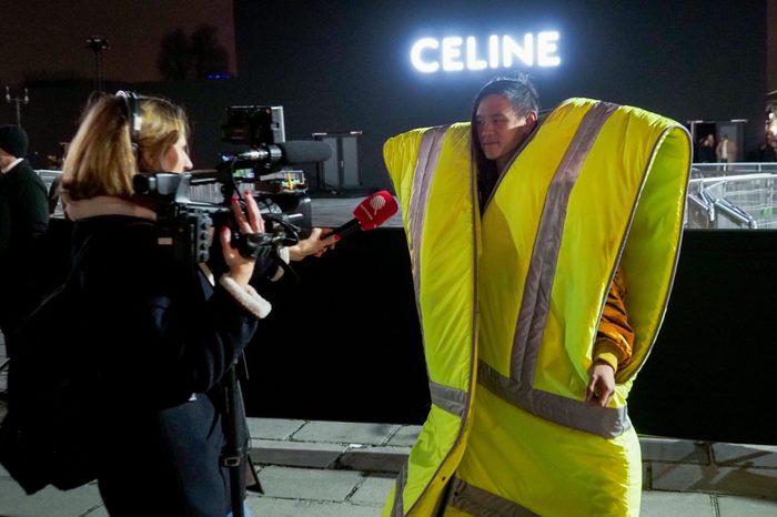 A man wearing a giant 'Gilet Jaune', Yellow vest 20 Jan 2019