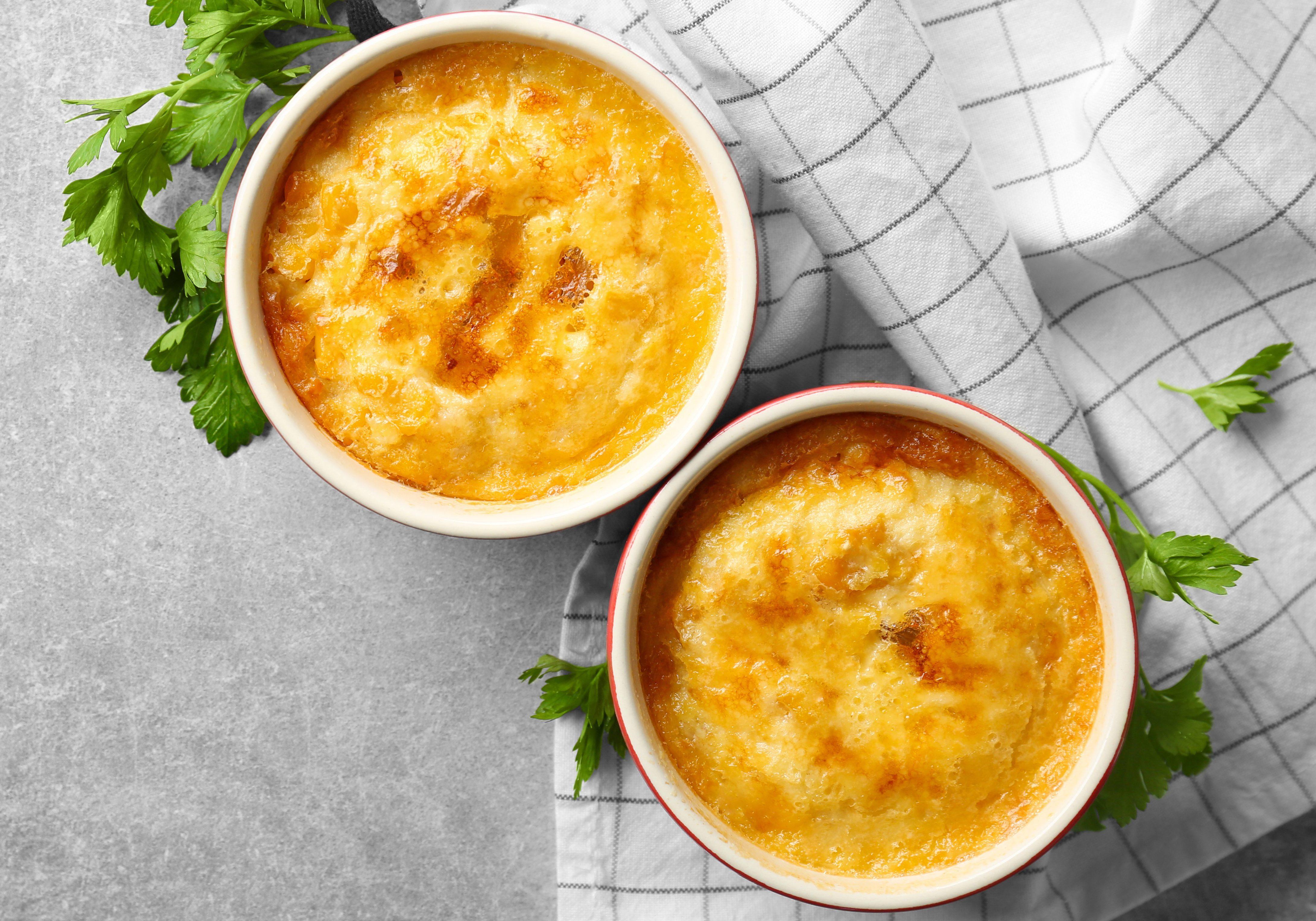 Ramekins with corn pudding on table