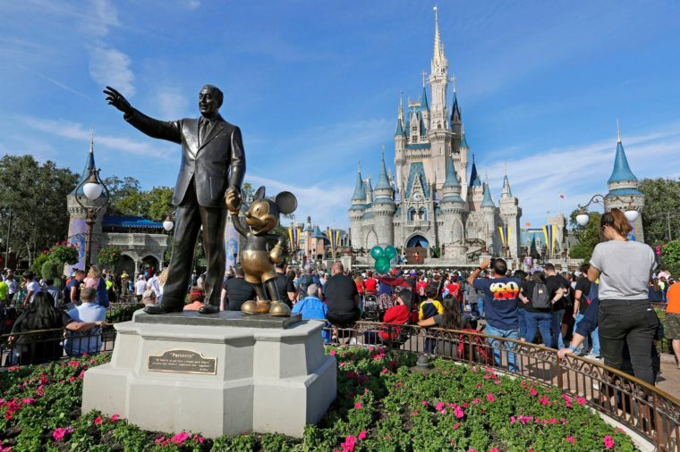 Mandatory Credit: Photo by John Raoux/AP/Shutterstock (10442147a) Guests watch a show near a statue of Walt Disney and Mickey Mouse in front of the Cinderella Castle at the Magic Kingdom at Walt Disney World in Lake Buena Vista, Fla. Disney World employees are easy targets. Tourists scream at them, sexually harass them and in the most serious cases, physically attack them, according to law enforcement reports Exchange-Disney Workers Abuse, Lake Buena Vista, USA - 09 Jan 2019