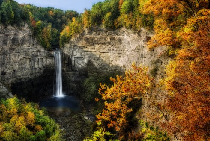 Taughannock Falls is located in Ulysses,Y New York. Photo taken from an overlook during fall. A gorgeous 215 foot waterfall found in the Finger Lakes region.