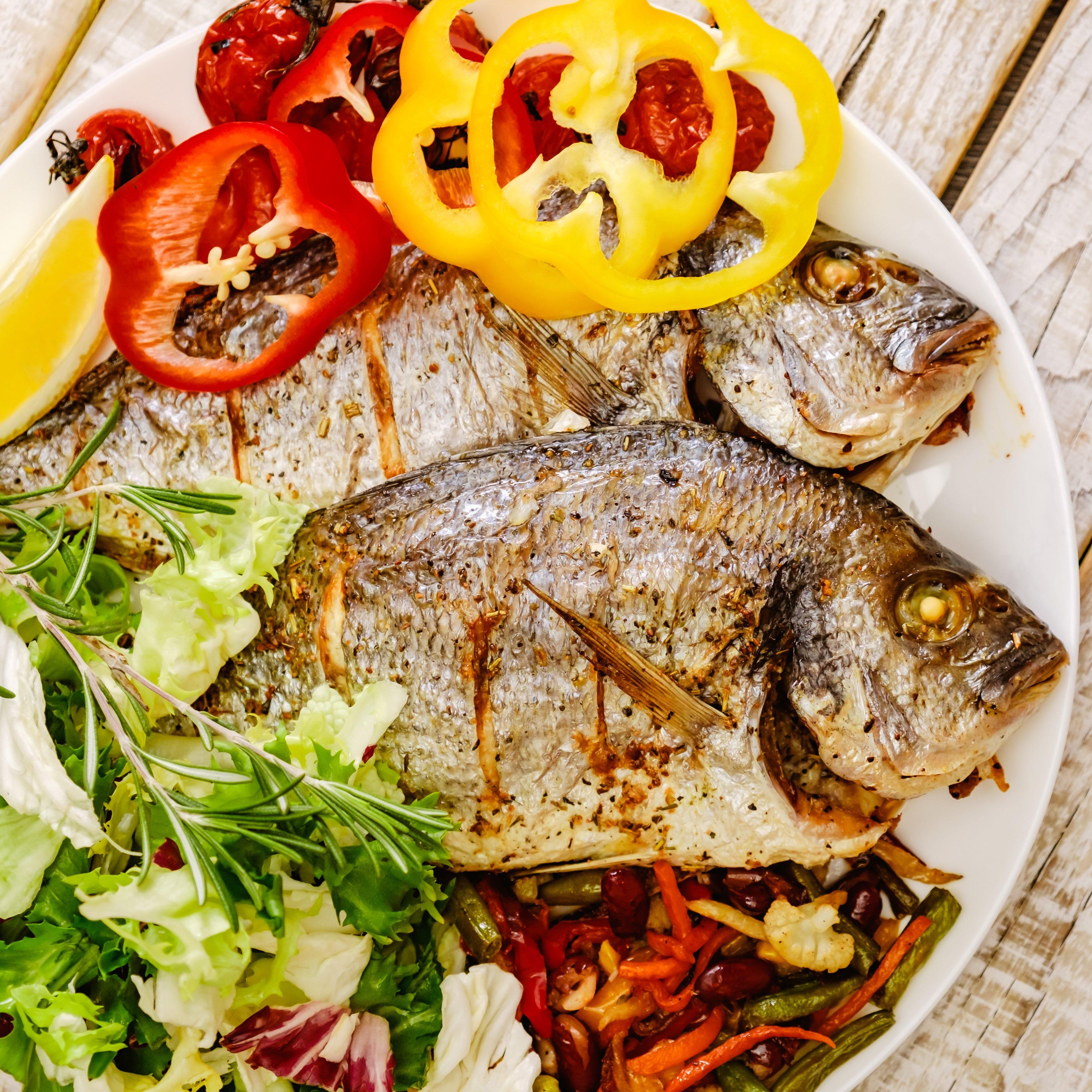 Food fish fresh dorado, meal seafood dinner with vegetables, diet gourmet.