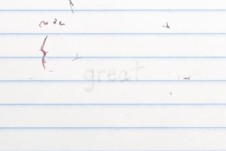 """erased text """"great"""" with eraser shavings on loose leaf paper"""