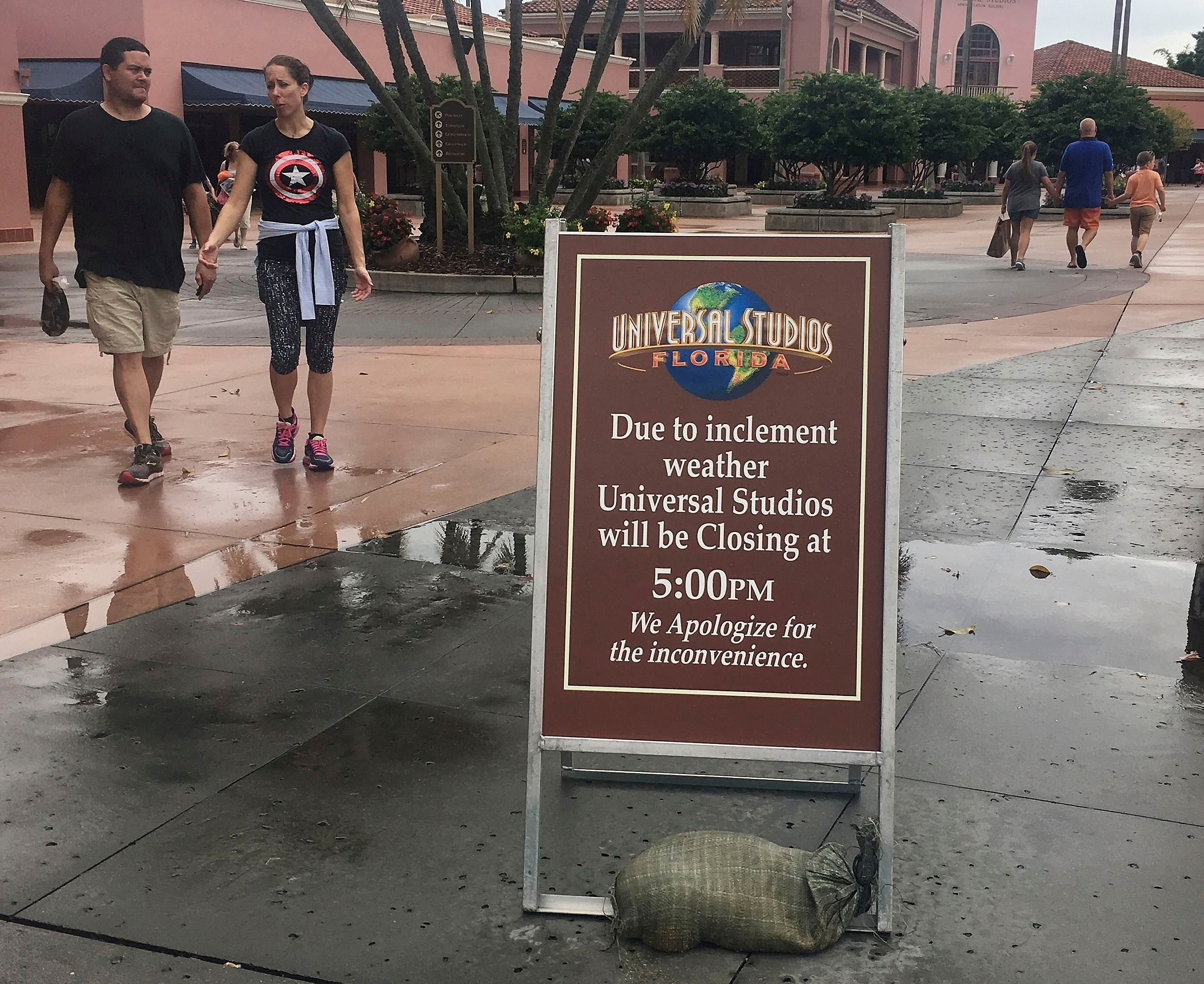 Mandatory Credit: Photo by Janelle Cogan/AP/Shutterstock (6099241a) Park guests depart from Universal Studios, in Orlando, Fla. Leaving more than 100 dead in its wake across the Caribbean, Hurricane Matthew steamed toward heavily populated Florida with terrifying winds of 140 mph Thursday, and 2 million people across the Southeast were warned to flee inland. In inland Orlando, Walt Disney World, Universal Studios and SeaWorld announced plans to close early today Hurricane Matthew, Orlando, Florida, USA - 06 Oct 2016