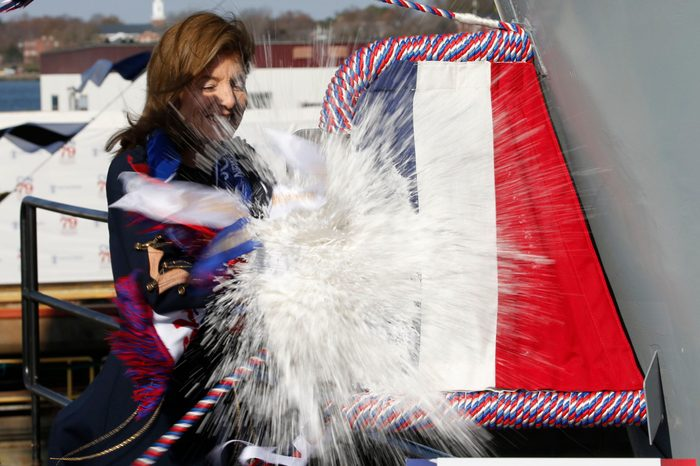 Caroline Kennedy, daughter of former President John F. Kennedy., smashes a bottle on the bow of the ship as she christens of the nuclear aircraft carrier John F. Kennedy at Newport News Shipbuilding in Newport News, Va 7 Dec 2019