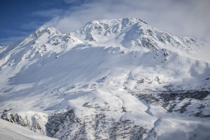 Snow covered 2928 meter high Piz Badus near city of Andermatt in central Switzerland