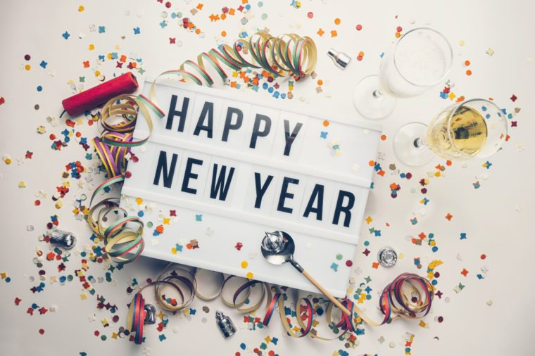 Happy New year displayed on a vintage lightbox with decoration for New Year's Eve, concept image
