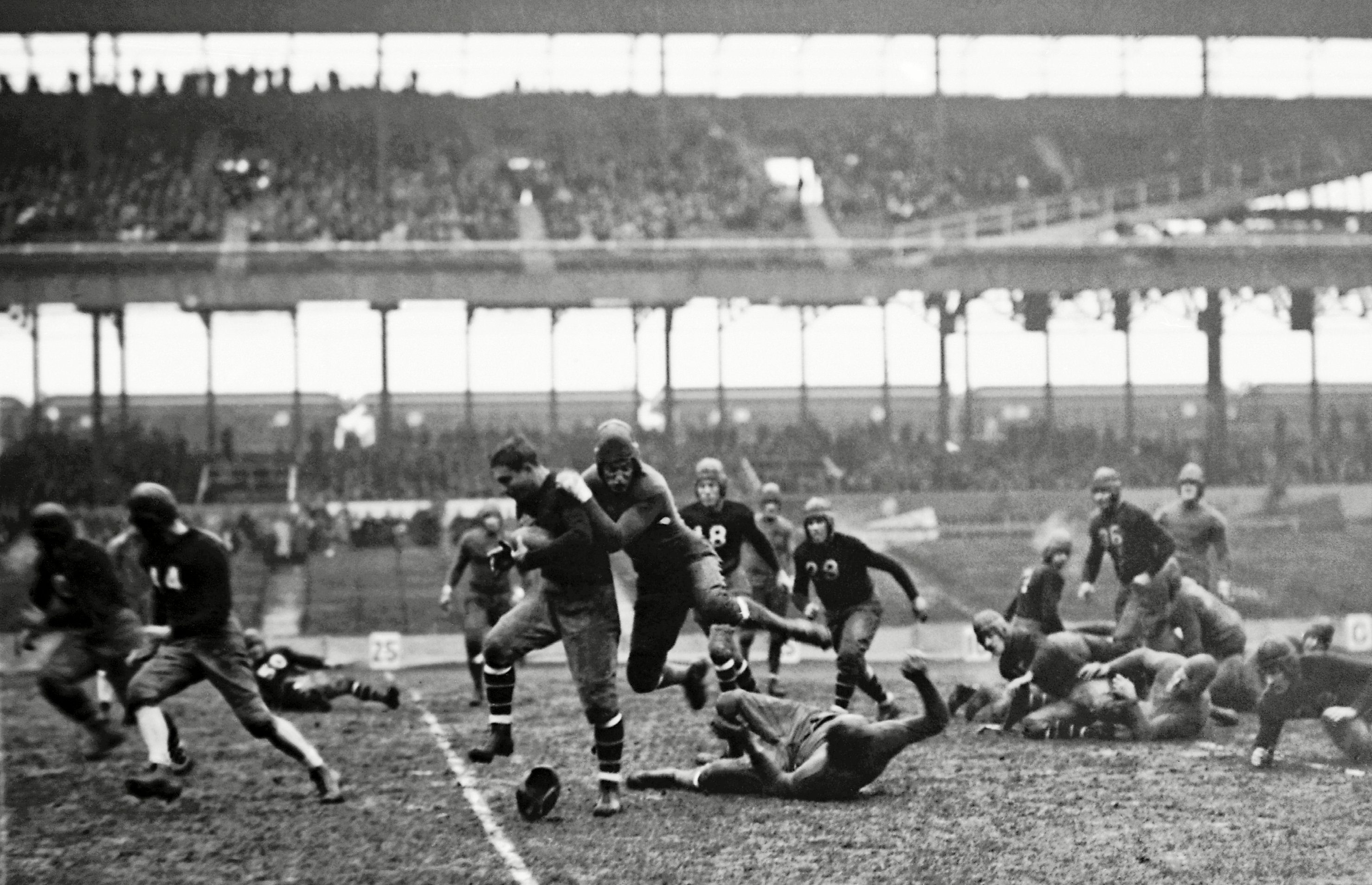 Mandatory Credit: Photo by Uncredited/AP/Shutterstock (10418274a) New York Giant's Benjamin Friedman is stopped after making a 10-yard gain against the Green Bay Packers during a football game at the Polo Grounds in New York City. The first season, 1920, the American Professional Football Association had 14 teams. Throughout a decade of flux, many franchises came and went NFL AT 100 The 1920s, New York, USA - 24 Nov 1929