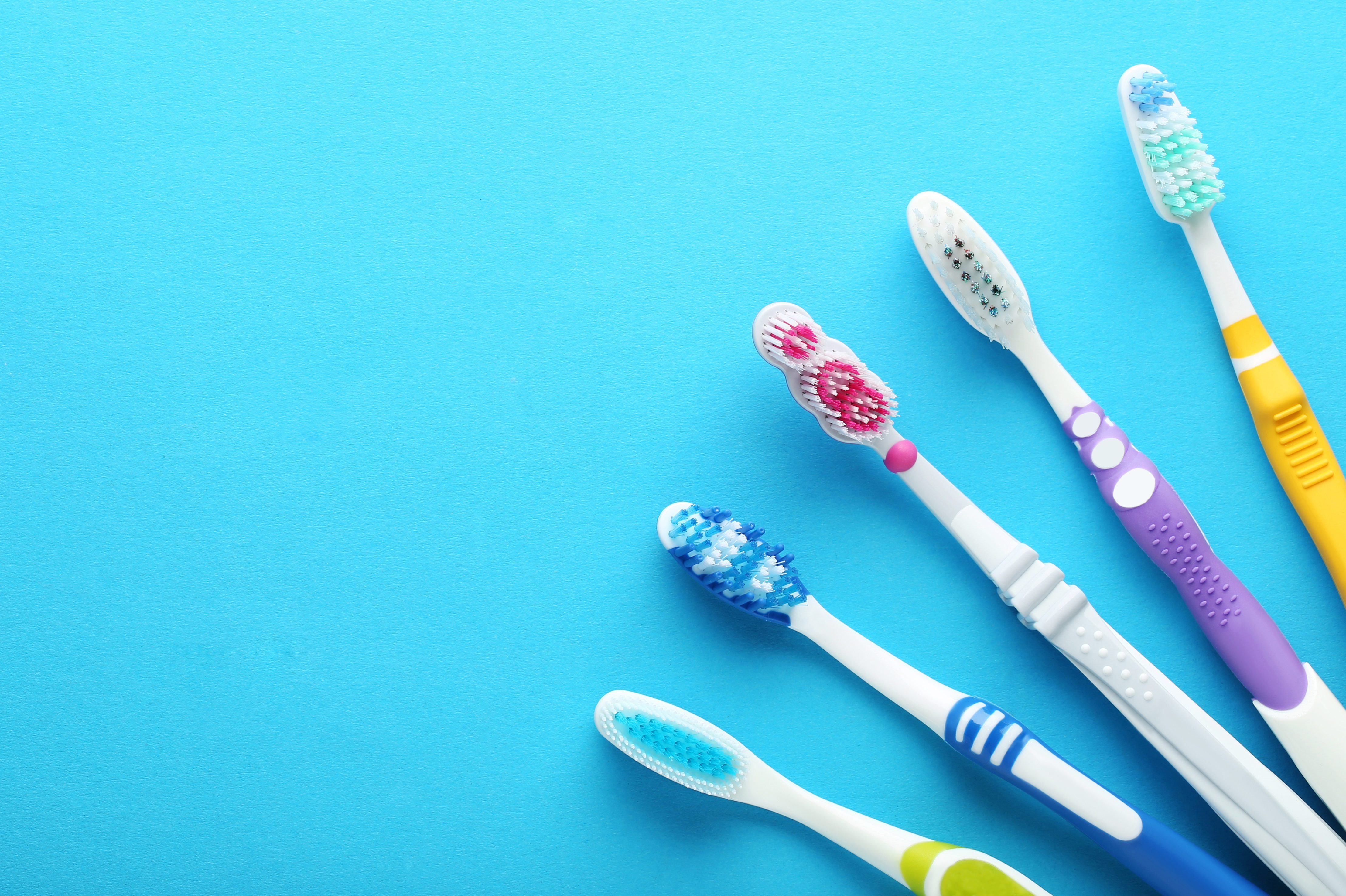 Toothbrushes on blue background