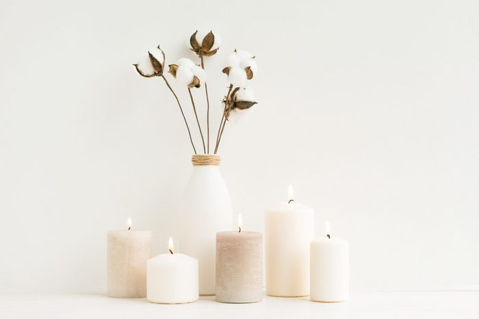 Spa composition. Candles, cotton flowers on white background. Flat lay, mock up. top view