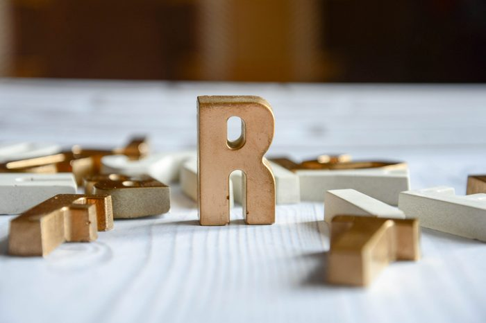 Letter R stands on white table