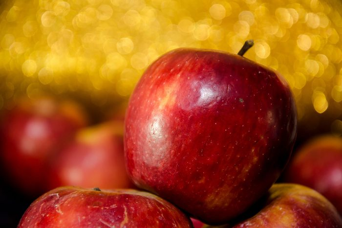 Red apples with bright golden background