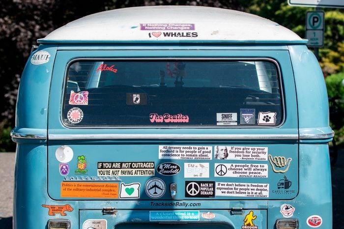 Volkswagen van with bumper stickers on it.