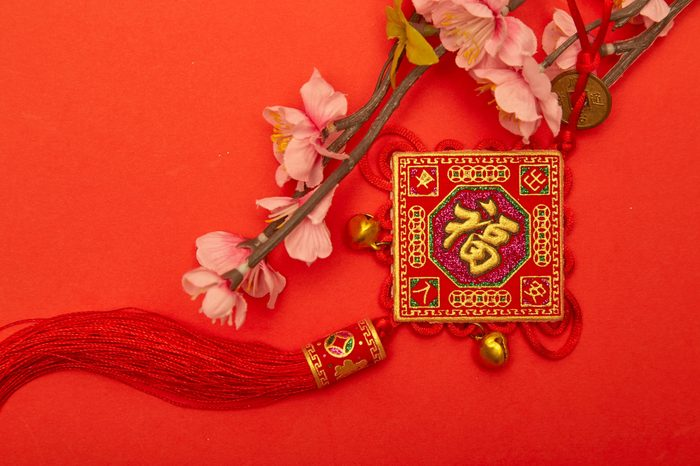 """Chinese new year 2020 ornament on red paper with Chinese letter """"FU"""" meaning meaning """"fortune"""" or """"good luck, gold ingot, Chinese lamp"""