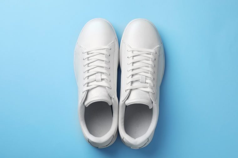 Pair of sneakers on color background, flat lay