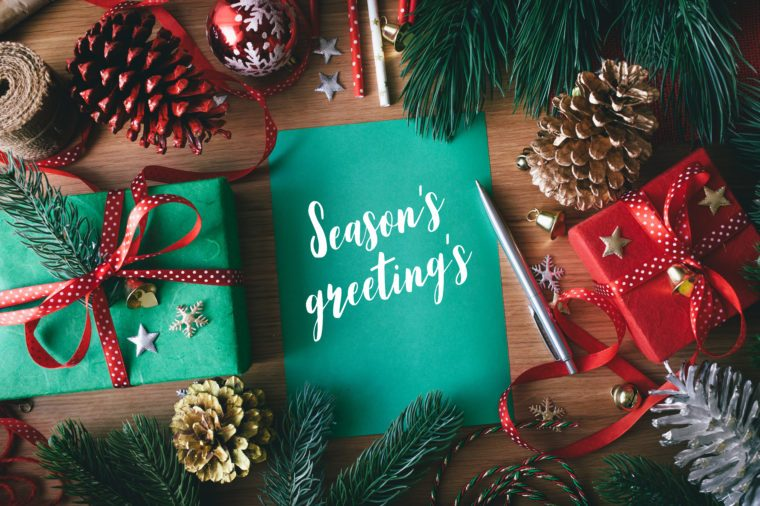 Season's greeting's concepts with cards and gift box present,ornament element on wood table background.Merry christmas and winter collection images