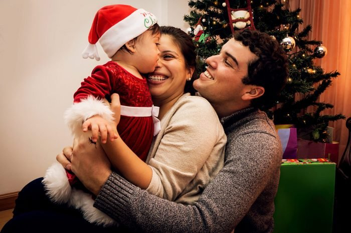 Happy young family enjoying their first christmas together