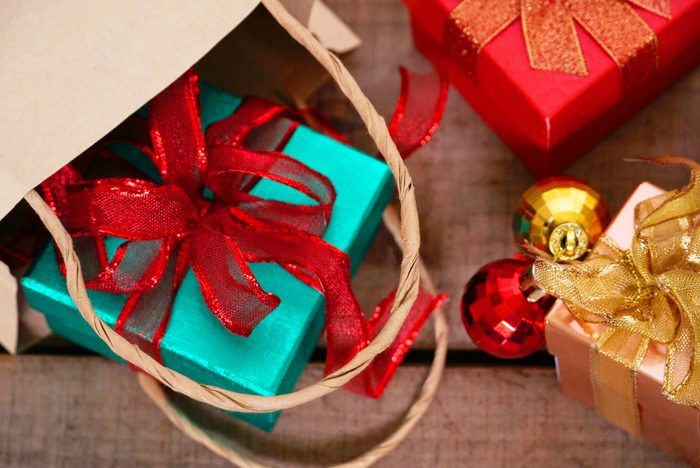 Gift boxes spill out from bag on the table