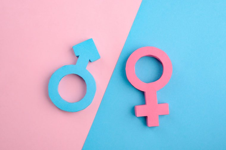 Male and female gender signs on blue and pink background. Relationship between men and women. Creative 3D paper art.