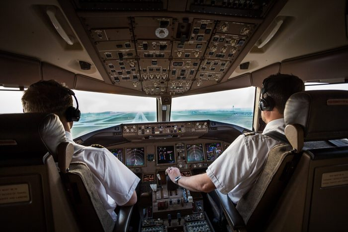 Pilots at work in cockpit