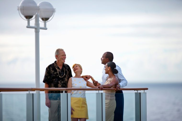 Two couples meeting on the deck of a cruise ship.