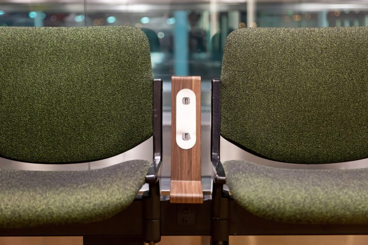 Green chairs with free standard USB power socket or USB port slot charger in airport. Travelling comfort