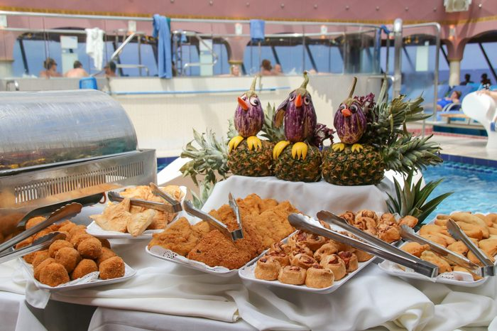 Buffet on the deck of a cruise ship, pool party